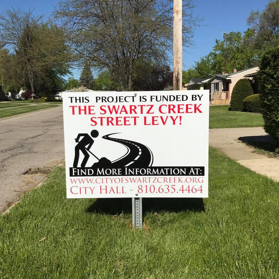 creek road work sign